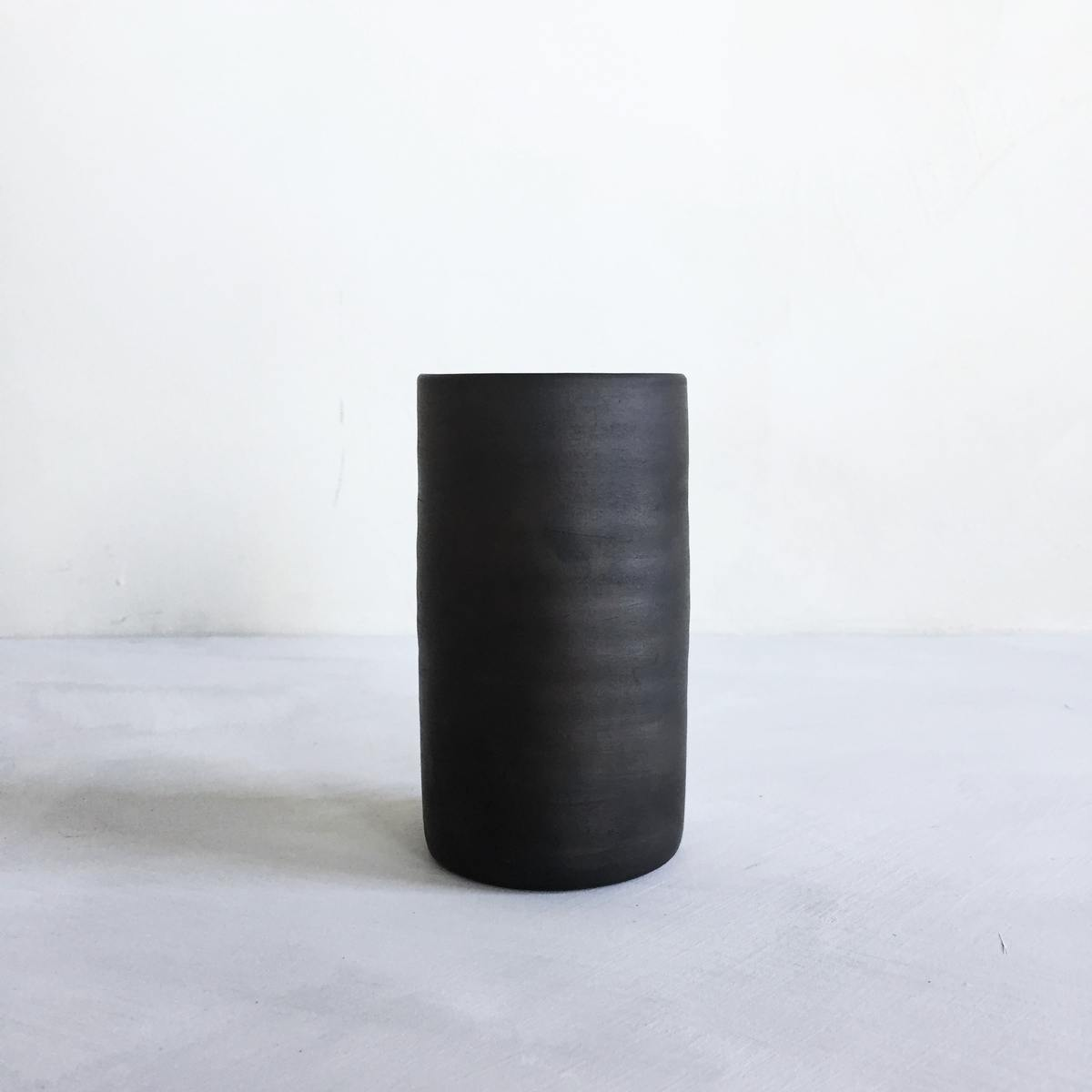 Reduced, black ceramic vase L